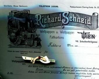 Krawattenklemme mit Uhrenteilen / Tie clip made of watch parts
