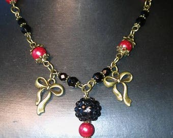 Old gold, red and black necklace with black glass pendant