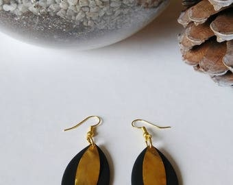 Black and gold earrings in polymer clay and gold metal