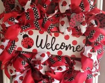 "18"" ladybug wreath with wooden welcome sign"