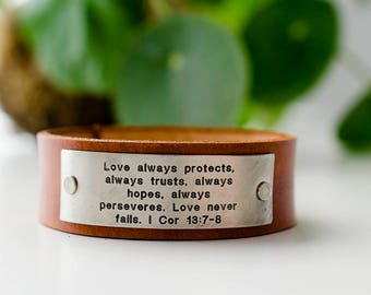 Love always protects, always trusts, always hopes, always perseveres. Love Never Fails. 1 Corinthians 13:7-8 Scripture Leather Cuff