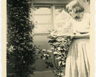 "Vintage Snapshot ""Feeding Her Trusted Feathered Friend"" Interior Design Girl Woman Hold Bird Cage Feeding Pet Black & White Vernacular - 150"