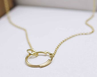 Interlocking Circle Necklace Gold with Small and Large Circles in 22K Gold.