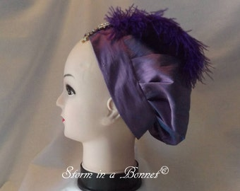 Regency Beret or Tam decorated with feather and decorative broach