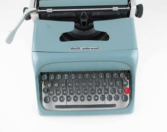 An 'Olivetti-Underwood' - Model 'Studio 44' Portable -Manual - Case and Typewriter Made in Barcelona, Spain - 1960s in Original Case - Teal