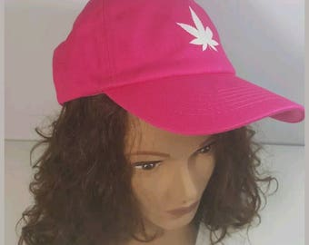 Women's Adjustable Pink low profile hat with customized weed leaf logo glows in the dark