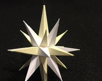 Four inch handmade paper Cream and White Moravian Star (Bethlehem Star) used as decoration, ornaments or art.