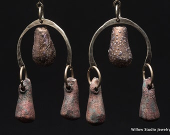 Water Buffalo, textured ceramic drops, rustic sterling silver arched yokes, an unexpected combination