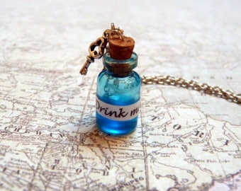 "Vial necklace ""drink me"" blue"