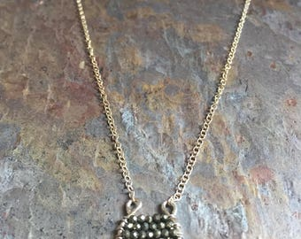 Silver necklace with a pyrite gemstone pendant