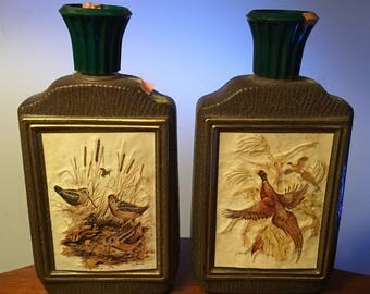 Two vintage Jim Beam decanters featuring wildlife art by Jame Lockhart