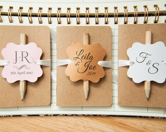 25+ Kraft wedding favours. Mini notebook favours with printed tags, ribbons and pencil. Notebook favours. Custom wedding favour place cards.