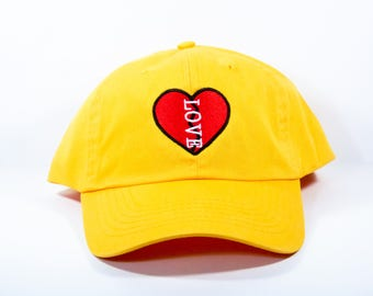 LOVE HEALS | Six Panel Unstructured Baseball Cap Dad Hat 100% Cotton | black white red purple yellow light pink
