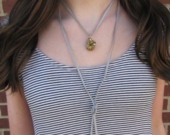 Gray leather with gold rock necklace