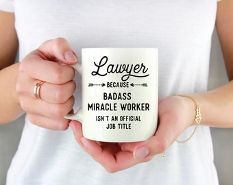 Gift for Lawyer - Lawyer, because badass miracle worker isn't an official job title. Funny Coffee Mugs 11oz or 15oz size.