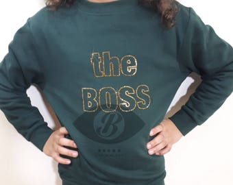 the Boss (gold rhinestones on green) sweater