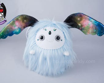Celestial Flibble sprite wing eared creature in blue with galaxy ears; Swarovski drop accent