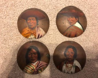Four copper art works with Ecuadorian native people