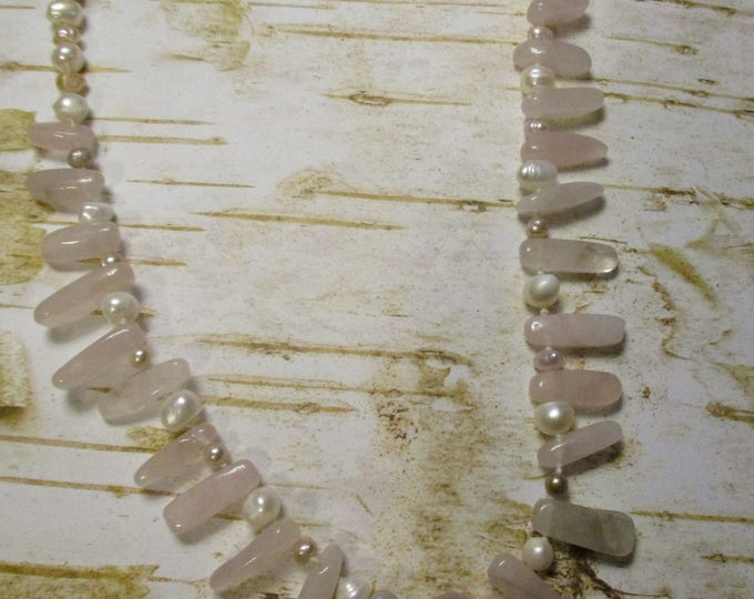Freshwater White Pearls 22 Inches long with Nickle Free Clasp 14mm Rose quartz Round Pendant accented by Rose Quartz Stones