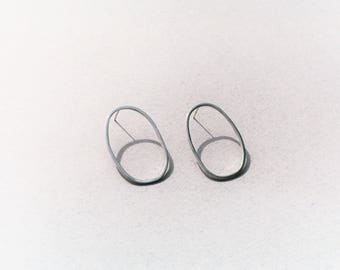 hand forged sterling silver oval earrings