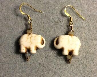 Light tan howlite gemstone elephant bead earrings adorned with tan Chinese crystal beads.