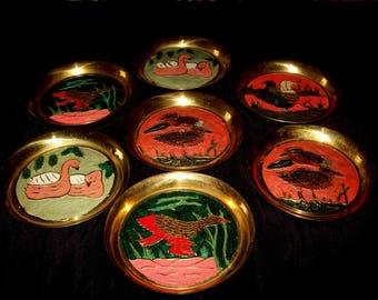7 small brass decorative plates
