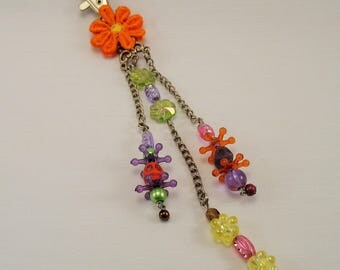 "Orange ""Colored vanity"" bag, skulls and flower charm."