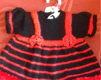 Hand knitted baby dress, knitted to fit a baby aged 0-3 months old