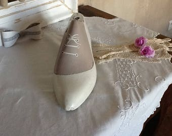 old boot or shoe white beige aged and decorated form