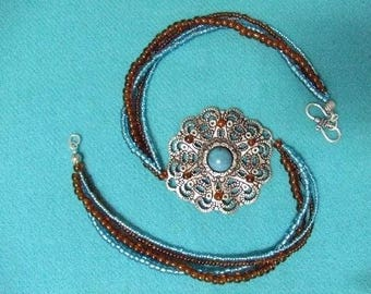 PRICE reduced: Turquoise Locket necklace and turquoise beads and caramel