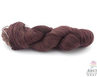 Sloth, hand dyed yarn. DK weight 1ply superwash merino/silk, merino/nylon, merino/tussah silk.Indie dyed semi solid dark brown yarn.