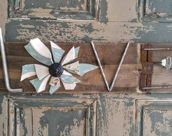 Love wall hanging word board with light blue broken pottery flower