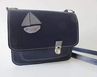 Dark blue leather bag.