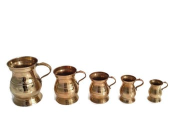 set of 5 vintage brass measuring pitchers