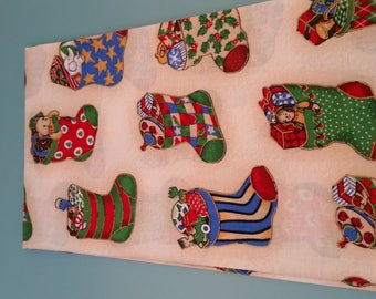 cotton fabric boots Christmas on a cream background
