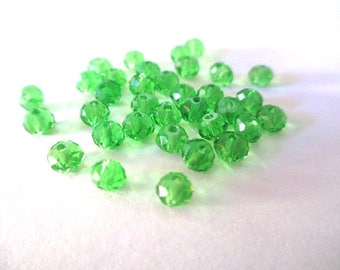 20 rondelle beads faceted green glass 4mm