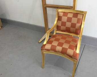 Upholstered arm chair with gold leafing wood frame