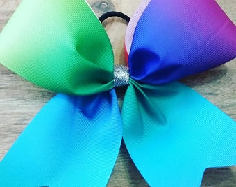 Rainbow cheer bow made with 3 inch wide ribbon and ponytail holder