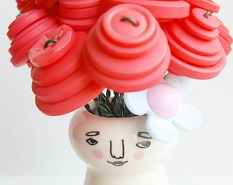 """Hilda"" Coral bouquet with happy lady vase"