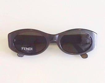 Vintage designer sunglasses by Fendi, pearl grey colour, elegant retro-style shape