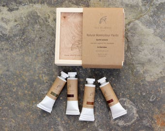 4 tubes of handmade watercolour paints in a wooden box. Earth colours