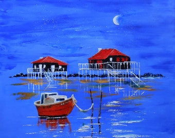Huts built on stits by moonlight