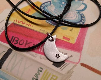 Handmade black cord necklace with a handmade aluminium moon with a black asterisk.