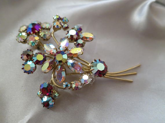 Beautiful vintage 1950s gold metal clear and red AB rhinestone flower spray brooch