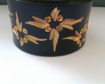 black plastic carved bangle gold enamel flowers