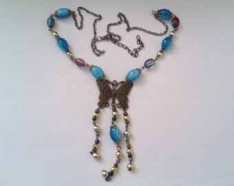 blue plastic bead necklace with butterfly pendant