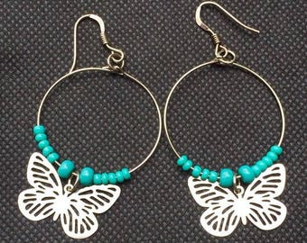 Small butterflies with turquoise beads and hoop earrings