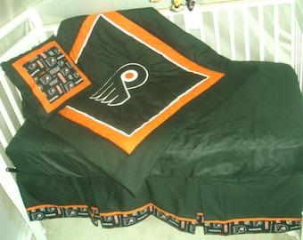 A Philadelphia Flyers crib skirt  NEW