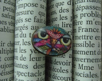 ring with a portrait of an OWL in a glass cabochon
