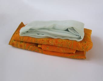 Mixed lot of solid fabric remnants - green and orange